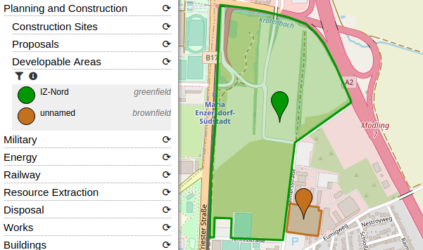 Image showing a screenshot of OpenStreetBrowser with a greenfield and a brownfield highlighted